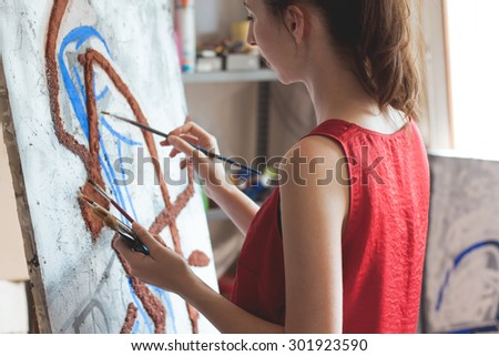 Artist working on her new project  - stock photo