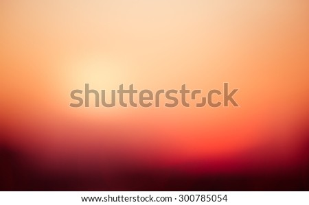 Artistic abstraction reminiscent of a desert sunrise. Blurred background of warm sunshine on the horizon. Vivid, creamy image with peaceful feeling and warmth.  Abstract background with calm energy. - stock photo