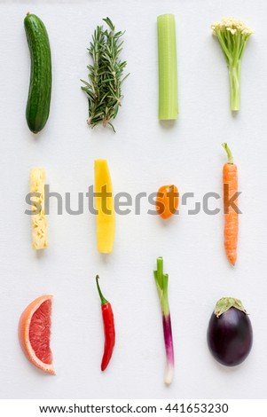 Artistic arrangement of fresh fruit and vegetables in colour gradient rainbow spectrum, interesting design food poster