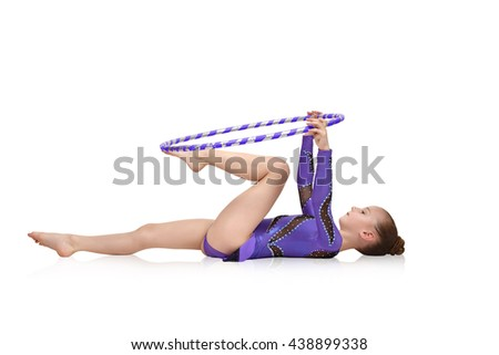 artistic athlete performs in blue clothes with hula hoop - stock photo