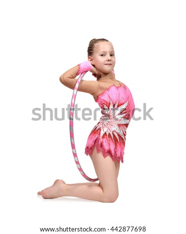 artistic athlete performs in pink clothes with hula hoop - stock photo