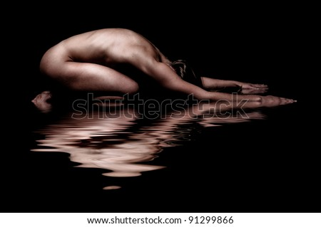 Artistic Body shot on water - stock photo