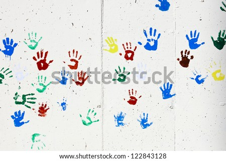 Artistic children hand prints on the wall