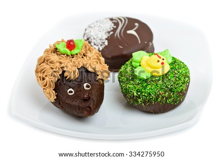Artistic chocolate cakes decorated as hedgehog, duck and seagull     - stock photo