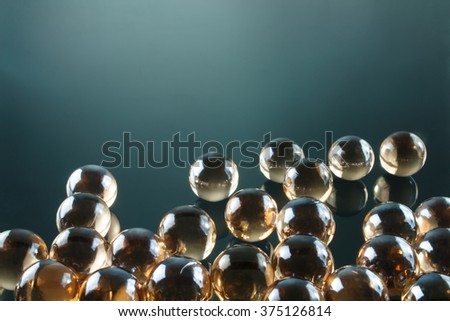 Artistic composition of marble clear glass ball - stock photo