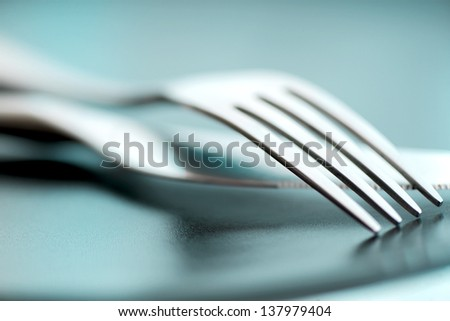 Artistic cutlery fork and knife - stock photo