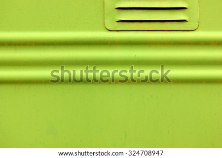 Artistic green metal poster template with embossed lines on side of an old train. Soft focus.