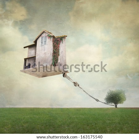 Artistic image representing an house floating in the air tied to a rope to the tree in a surreal vintage background - stock photo