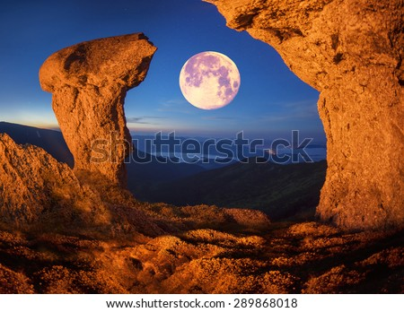 Artistic lighting unreal mountain scenery while rock climbing in the wild mountains provides a unique fantastic effect unearthly planets with fabulous landscapes of Mars - stock photo