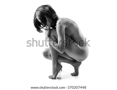 Artistic nude in black and white - stock photo