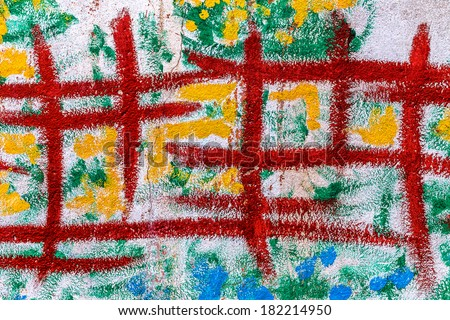 Artistic palette with oil paint on a concrete wall. - stock photo