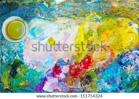 Artistic palette with oils paints. - stock photo