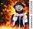 Artistic photo illustration of a comical bearded terrorist hyjacking a model plane in flames and fire - stock photo