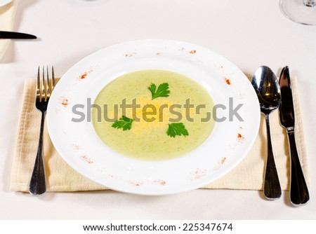 Artistic plating of delicious vegetable soup served in a bowl at table garnish with coriander leaves - stock photo