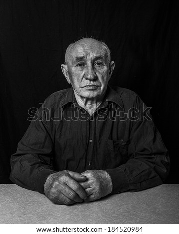 Artistic portrait of an old man - stock photo