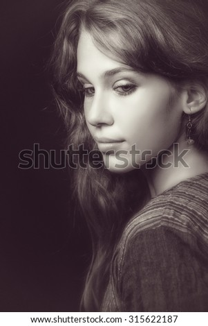 Artistic portrait of sensual beautiful young woman