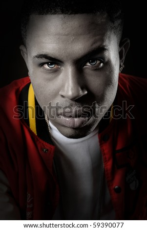 Artistic portrait of young African American man - stock photo