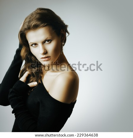 Artistic portrait of young beautiful brunette woman