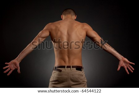 Artistic portrait of young male on a dark background - stock photo
