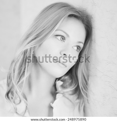 Artistic portrait of young sad blond. Shallow depth of field