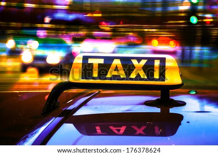 artistic processed picture of a taxi sign at night - stock photo