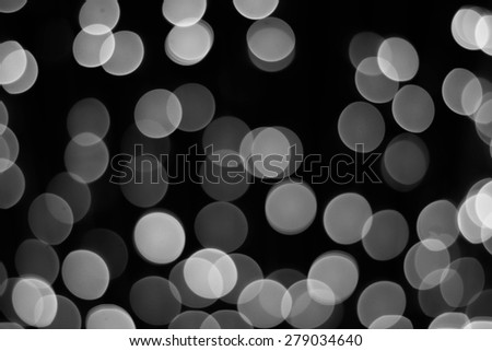 Artistic style - bokehs of lights in the background with blurring lights for your design, black and white color tone - stock photo