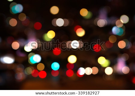 Artistic style - Defocused abstract pattern bokeh city lights in the blurred background from urban night party for your design
