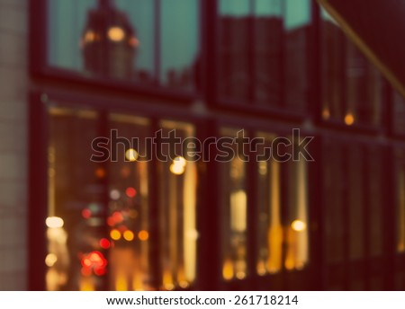 Artistic style - Defocused, blurred urban background, reflection in office windows at night - stock photo
