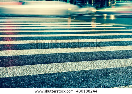 Artistic style - Vintage style, Crosswalk and pedestrian at modern city zebra crossing street in rainy day. Blur abstract.Background concept. - stock photo