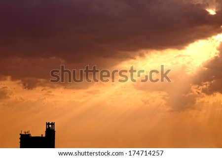 Artistic sunset with bright sky, birds and clouds