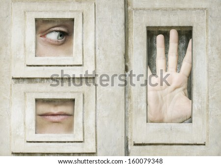 Artistic surreal composition of an eye a mouth and an opened hand framed - stock photo