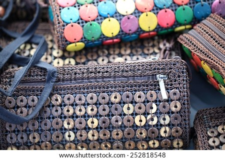 artistic variety shade tone colors ornaments patterns of thai silk textiles with traditional cultural decoration ornaments design by village people for sale in a street market in THAILAND  - stock photo