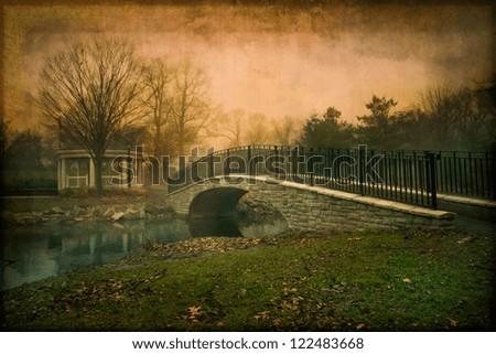 Artistic vintage textured pond with footbridge - stock photo