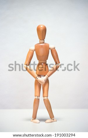 Artists mannequin needing to use the bathroom - stock photo