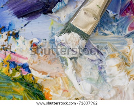 Artists oil paints and brush multicolored closeup - stock photo