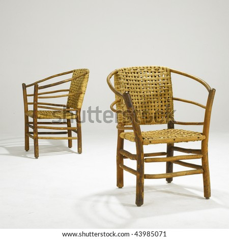 arts and crafts wicker dining room chairs - stock photo