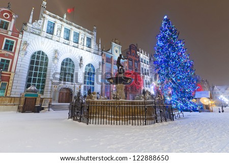 Artus Court  of Gdansk in winter scenery with Christmas tree, Poland