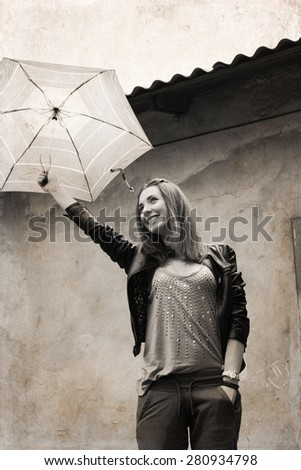 Artwork in retro style, young woman with umbrella  near the old house, smiling