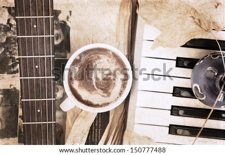 artwork  in vintage style,  cup of coffee and musical instruments - stock photo