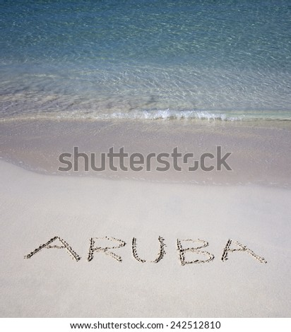 ARUBA written in sand with water  - stock photo