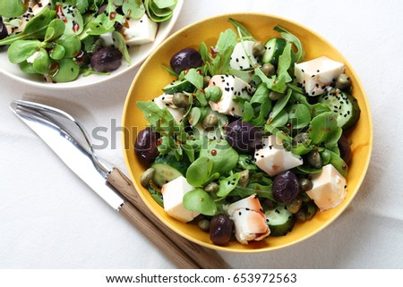 Arugula, tofu, capers, cucumber, olives, purslane, azalea seeds and pomegranate sauce salad