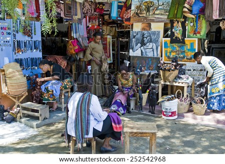 Aruscha, Tanzania - September 2 2008: Local people end vendors in the Masai craft market - stock photo
