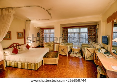 ARUSHA, TANZANIA - OCTOBER 20, 2014 : Typical african quality hotel room in the Impala Hotel, Arusha. Hdr processed.