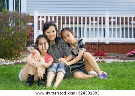 Asain chinese mother with her two teenager grils