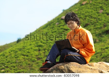 asain Man with notebook at day