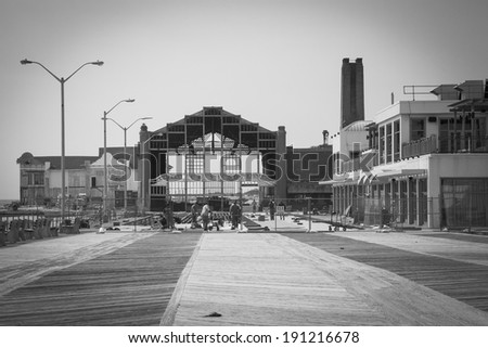 ASBURY PARK, NJ - APRIL 9: Workers repair the Asbury Park Boardwalk in New Jersey six months after Hurricane Sandy. Photo taken April 9, 2013. - stock photo