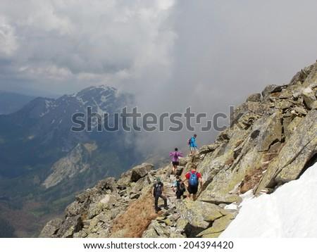 Ascent to Svinica peak in High Tatras, Poland - stock photo