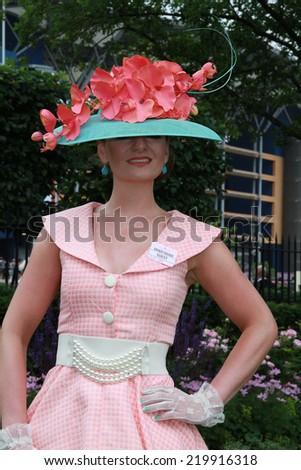 ASCOT - JUN 19: Racegoer attends Ladies Day at Royal Ascot at Ascot racecourse, on Jun 19, 2014 in Ascot  - stock photo