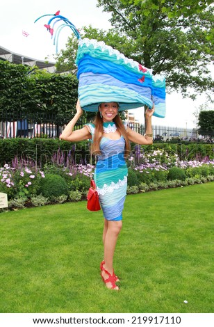 ASCOT - JUN 19: Racegoer attends Ladies Day at Royal Ascot at Ascot racecourse, on Jun 19, 2014 in Ascot