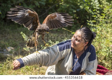 ASENVOGRAD, BULGARIA - JUNE 25, 2016 - Medieval fair in Asenovgrad recreating the life of Bulgarians during the Middle ages. Woman with a trained falcon. - stock photo